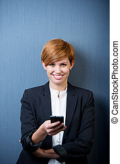 Businesswoman Text Messaging On Mobile Phone - Handsome...