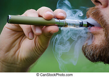 Smoking an electronic cigarette - Close-up of a man vaping...