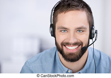 Customer Service Executive With Headset - closeup of happy...