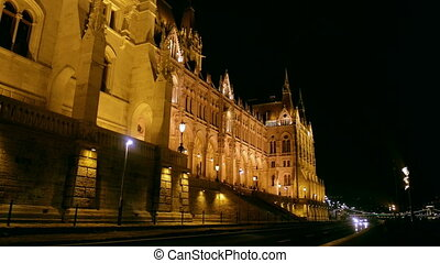 Hungarian Parliament at night with cars