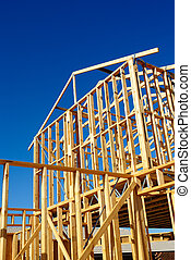 Frame of a new home - New residential construction house...