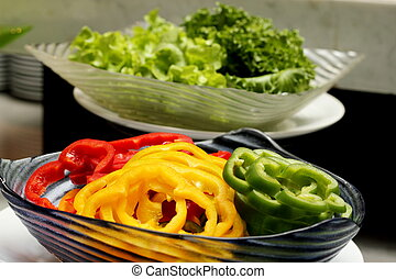 Sweet pepper cut into pieces placed in cups - A Sweet pepper...