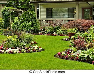 Manicured Yard - A beautifully arranged flower garden and...