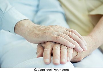 Hands of seniors - Close-up of senior male hands in hand of...