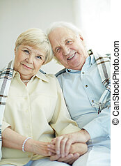 Devoted couple - Portrait of cheerful senior couple looking...