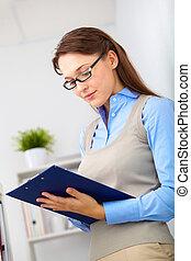White collar worker - Portrait of elegant secretary making...
