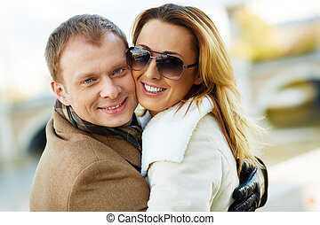 In embrace - Portrait of happy urban couple in embrace...