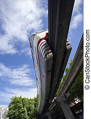 Monorail Transit Train Travels Over Neighborhood Carrying...