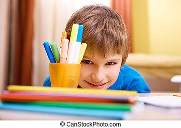Cute schoolboy - Close-up of schoolboy looking at camera...
