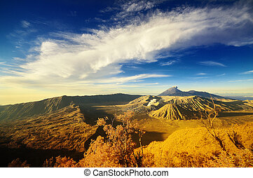 Bromo Mountain under cloudy bluesky
