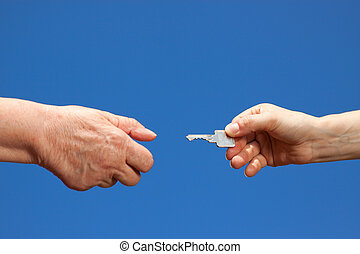 Key handover between young and old woman