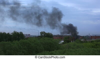 Black smoke in a residential area. Fire in Omsk. Russia.