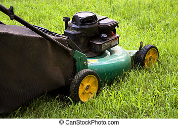 Lawn Mower - A modern lawn mower cutting through the grass.