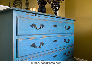 Close up on the drawers of a dresser - Close up on a blue...