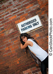 Authorised Parking Only - An attractive young Asian women in...