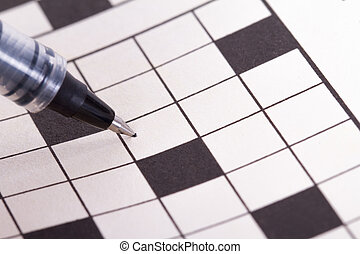 Blank Crossword Puzzle with Black Pen - Close up of blank...