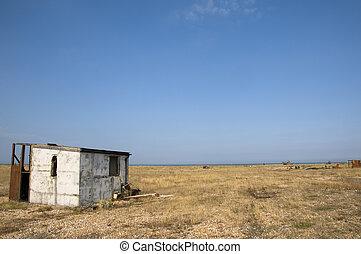 Beach hut - An abandoned beach hut on the beach at Dungeness