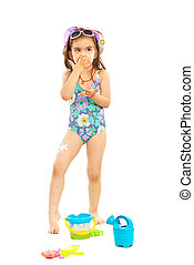 Girl applying sunblock cream - Preschooler girl applying...