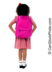 Primary school girl facing wall - Primary school girl in...