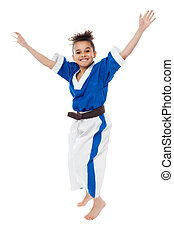 Enthusiastic young girl kid in karate uniform - Young karate...