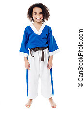Smiling young girl in karate uniform - Young girl in karate...