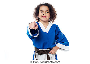 Smiling karate girl pointing towards you - Cheerful karate...