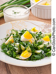 salad of boiled eggs, green onions and cucumber with yogurt...
