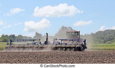 Planting Farm Field - Planter planting seed in a farm field