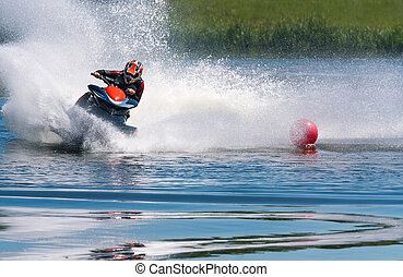 Jet ski water sport - Man riding wave runner on river