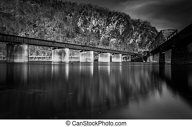 Train bridges crossing the Potomac River, in Harper's Ferry,...