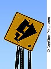 Tilted Road Sign - Warning sign of steep hill ahead