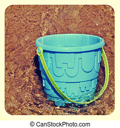 beach pail in the sea - picture of a blue beach pail in the...