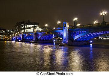 Southwark Bridge in London - Colorfully illuminated...