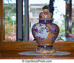 the Chinese vase and a mirror