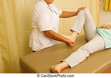 Physiotherapist treating quadriceps muscle,Rehabitation  for muscle weakness