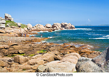 tourists on Pink Granite Coast in Brittany