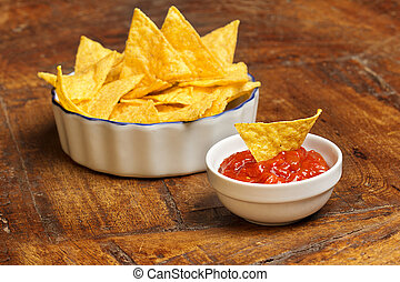 mexican appetizer of tortilla chips and tomato sauce