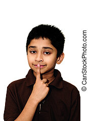 Shh - An handsome Indian kid showing sign to be quiet