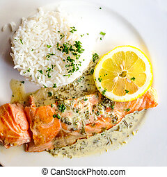 grilled salmon and rice-french cuisine dish with tomato and...