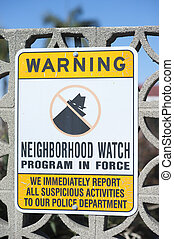 Neighborhood watch sign warning for criminals