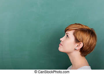 Student thinks about something - Thoughtful female student...