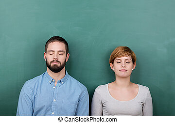 Students With Closed Eyes Chalkboard - Thoughtful young male...
