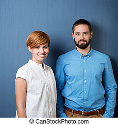 Young Business People With Blue Background - smiling young...