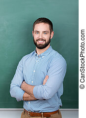 Professor Standing Against Chalkboard - Portrait of...