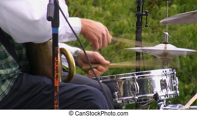 Brass band drummer - Brass band in uniform playing popular...