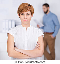 Businesswoman With Coworker In Background