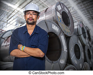 worker at a warehouse - Asian worker at a coil material...