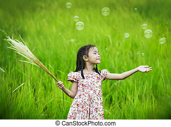 little girl outdoors in sunny summer day
