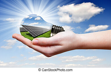 eco bulb in hand - Bulb with of solar panel in hand
