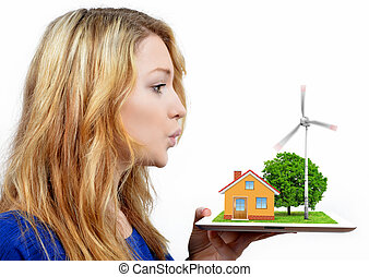 girl blowing on the wind turbine isolated on white